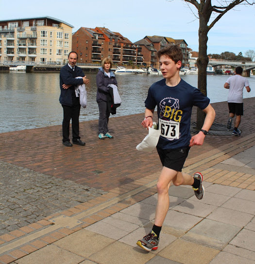 A runner catches the attention of passers-by on the riverside at the Kingston Urban Race. Photo courtesy of Mark Howells.