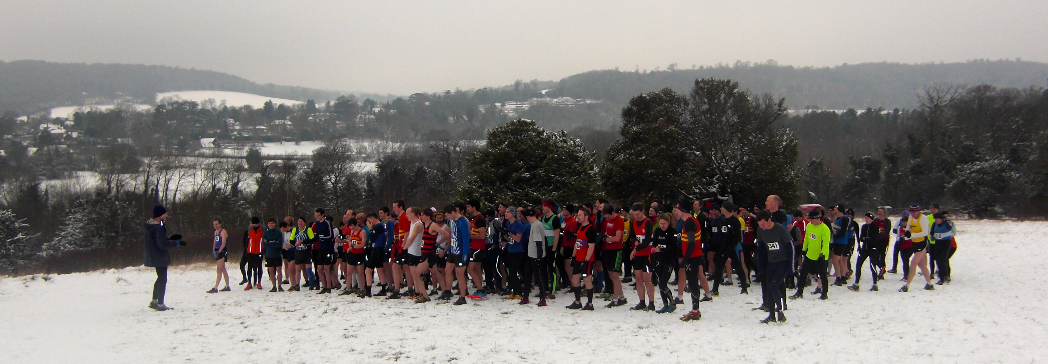 Runners gather on the snowy start line for the 32nd Box Hill Fell Race