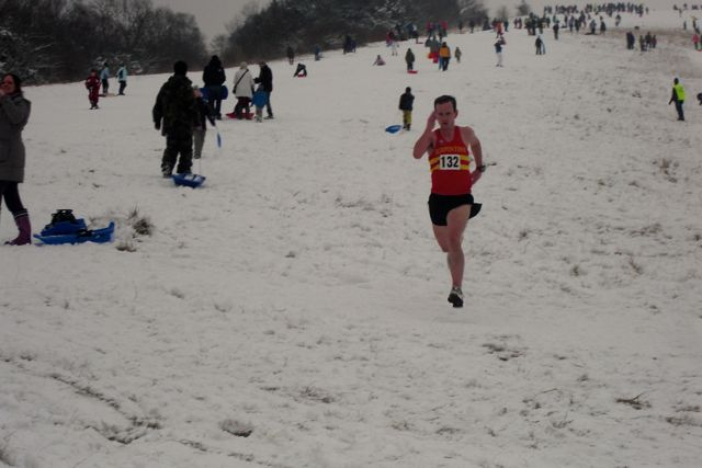 Harold Wyber strides home in shorts and vest among those sledging on Box Hill